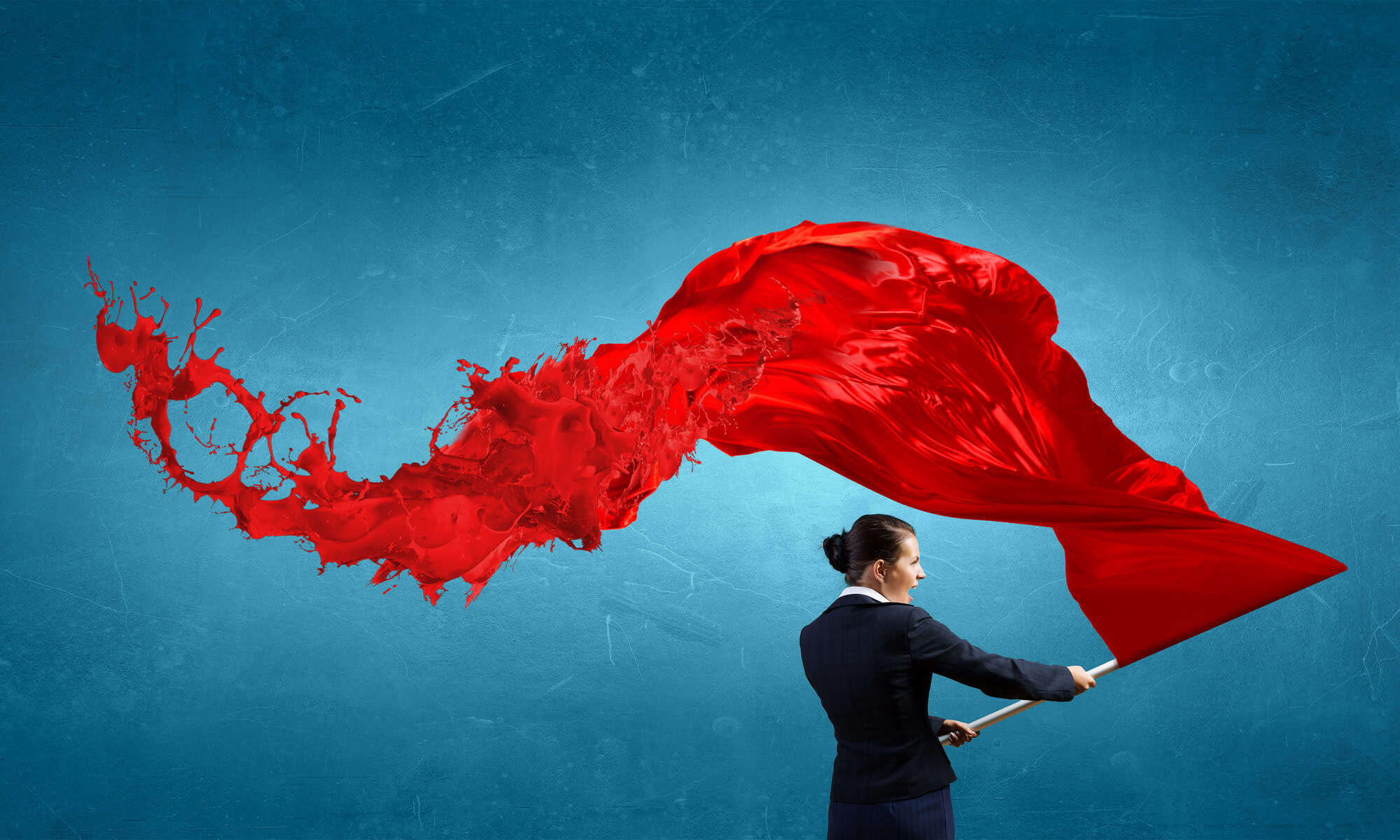 woman holding red flag